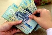 Đồng tiền sử dụng trong giao dịch mua, bán cổ phần tổ chức tín dụng Việt Nam